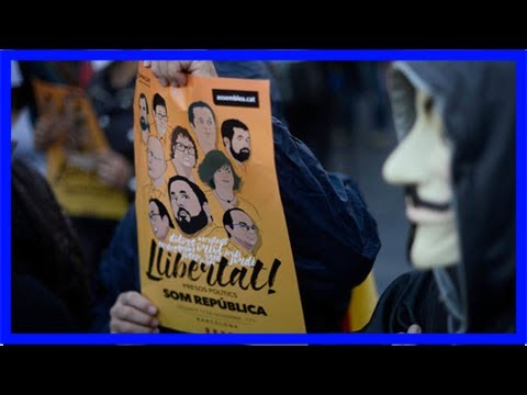 Million mask march: anonymous takes to barcelona streets to back catalonia independence