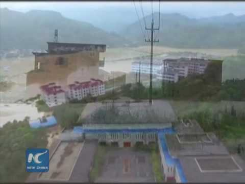 Over 20 killed in S China storms