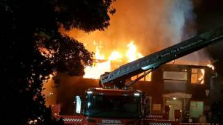 Fire rages through Surrey hospital after locals hear loud explosions
