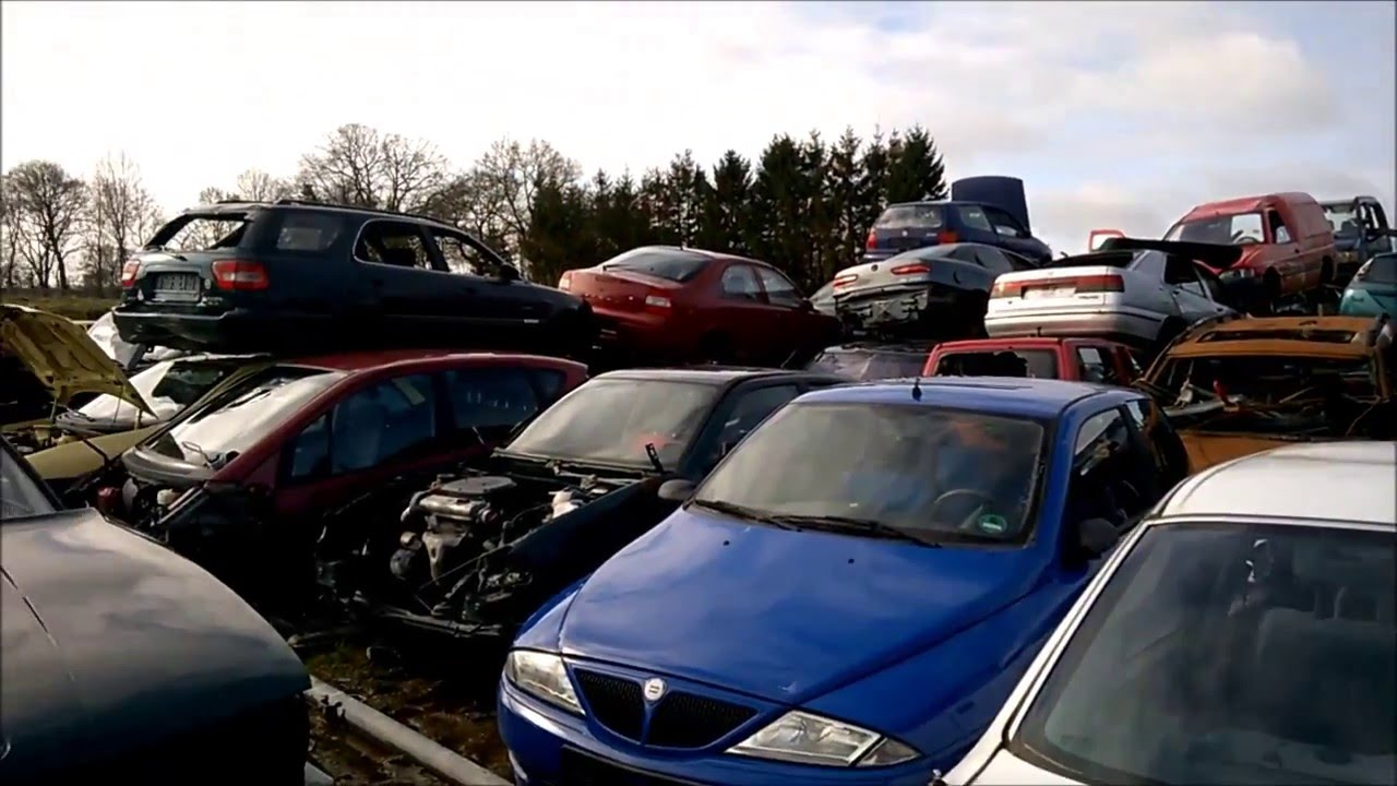 searching for some hubcaps on a scrapyard - YouTube