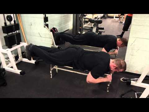 Lying leg curls in cable machine