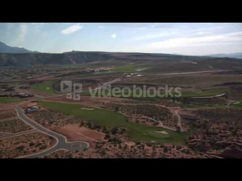 aerial shot of desert golf course high altitude w11xwzx b