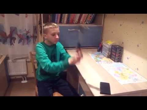 Russian Kid Breaks his mobile phone ( FAIL )