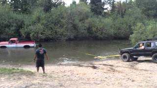 Ford ranger stuck in river rescued by jeep cherokee