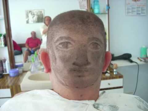 Tagli capelli uomo rasati con disegni