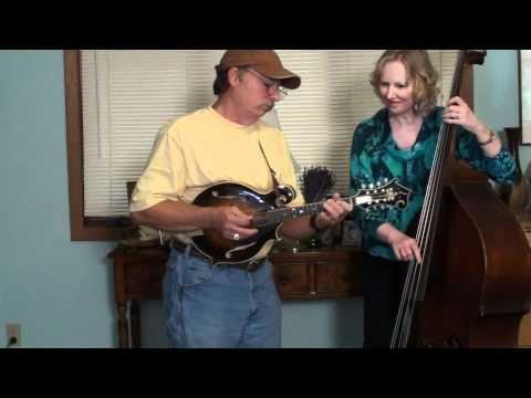 Billie Jordan and her husband Russ on upright bass and mandolin perform