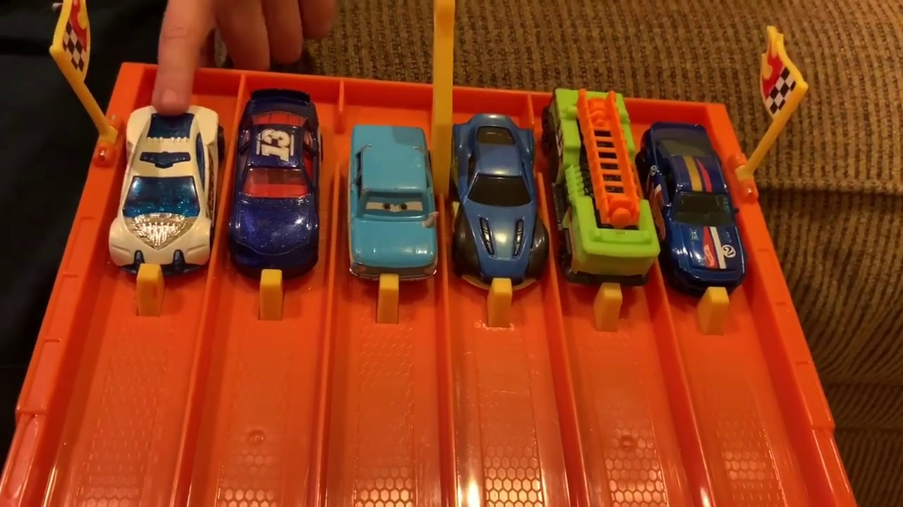 Shorty races hot wheels cars on a 6 lane track!!