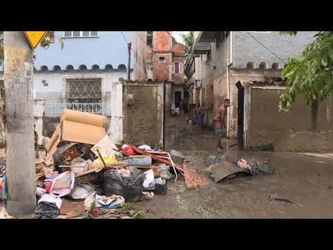 Rio residents struggle to recover after flash floods