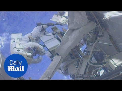 Astronauts conduct spacewalk outside ISS to fix cooling system - Daily Mail