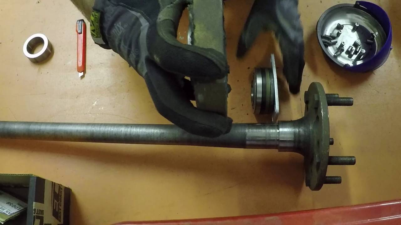 Pressing on axle bearing, strange c-clip eliminator, hybrid axle.