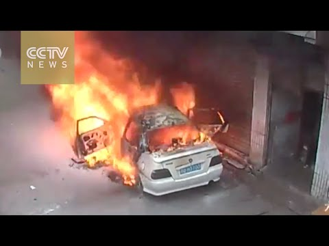 Two boys throw firecrackers into a car, burn it down