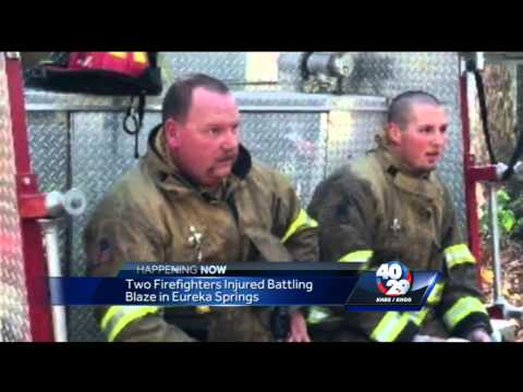 Two firefighters injured battling fire
