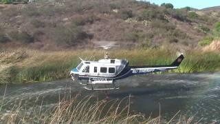 Two helicopters taking on fire by fueling from a near by lake in San Marcos, CA 10/20/2009 [HD]