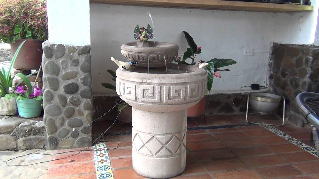Fuente luminosa en piedra con bomba solar youtube for Bombas solares para fuentes de jardin