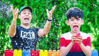 Jason and Alex play with water outside