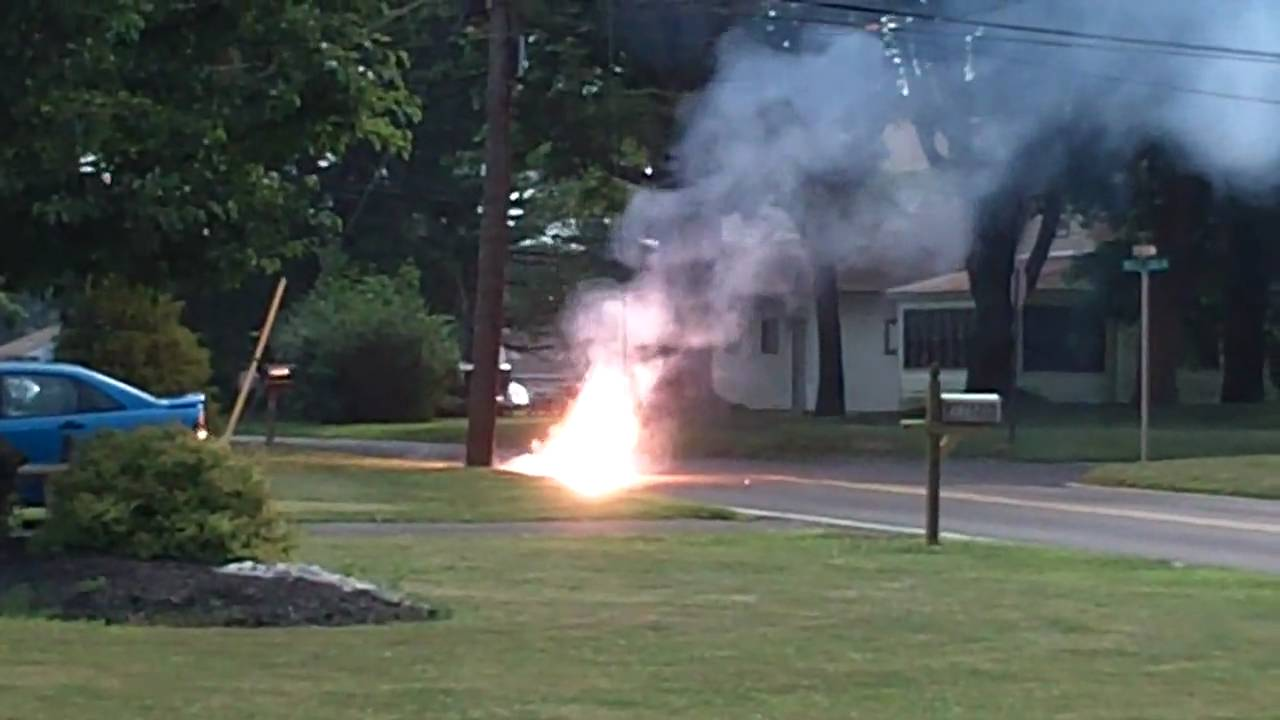 our streets power line down arcing in the street setting it on