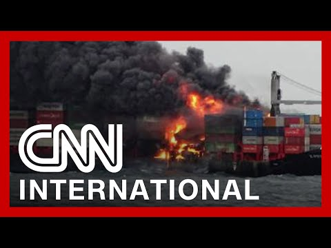Burning ship may cause disastrous oil spill