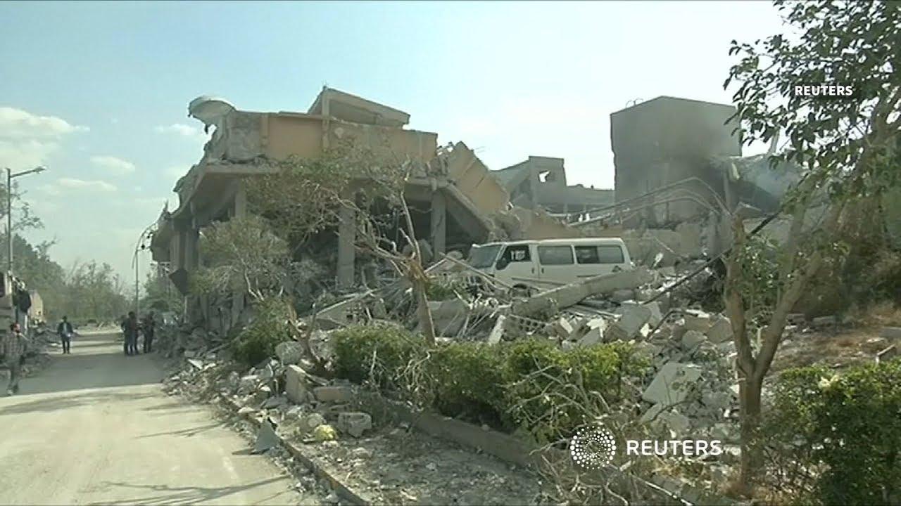 British PM defends air strikes in Syria against parliament critics