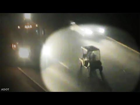 Golf cart with no headlights drives down freeway at night