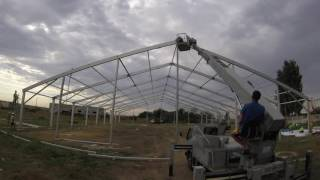 видео: монтаж тентовой конструкции 30х40