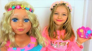 Polina wants to be a hairdresser doing hairstyles and make-up with a Baby Born Sister Mannequin