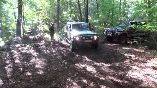 Nissan Patrol going downhill, another one uphill in a forest