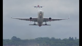 Boeing 767 smooth takeoff while another B787 Dreamliner is landing behind