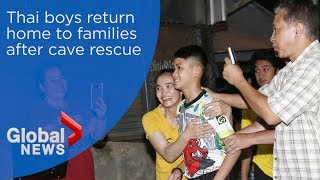 Thai boys rescued from cave return home to families