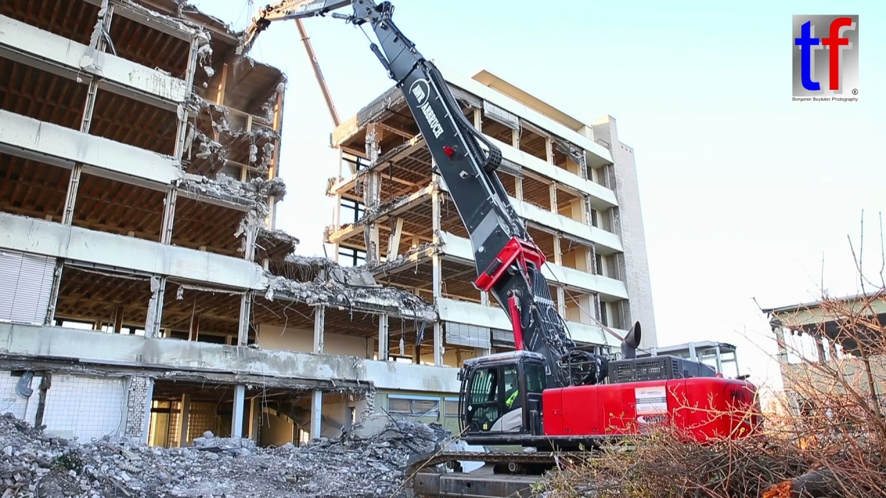 High Rise Demolition : Hitachi kmc btv high rise demolition abbruch