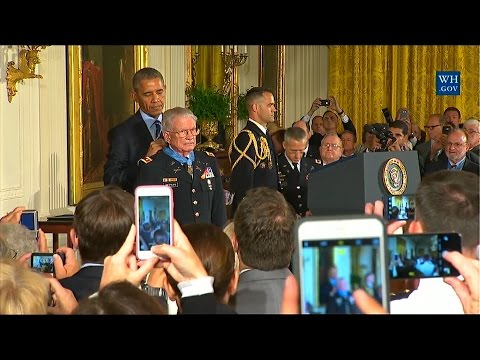 During a ceremony at the White House, President Barack Obama presents retired Army Lt. Col. Charles Kettles with the Medal of Honor for his heroic actions during the Vietnam War, July 18, 2016.