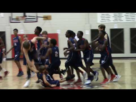 Toombs County Middle School's Maleke Day hits a half court shot