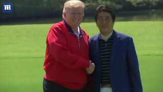 President Trump meets Japan Prime Minister Shinzo Abe on golf course