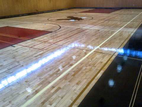 Gymnasium Hardwood floor refinishing, painted basket ball court Vancouver BC