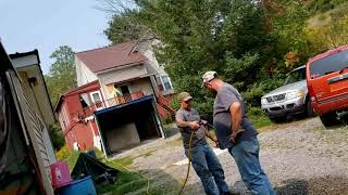 Dana's Garage Ep 22 Building a Garage from Pallet racking Concreting Smoothing and Drying Pt 2