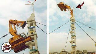 Beginilah Keahlian Operator Excavator Tingkat Dewa Yang Mampu Memanjat Menara!