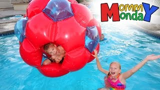 giant red ball swimming party    mommy monday