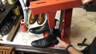 Tight boots being stretched on the width