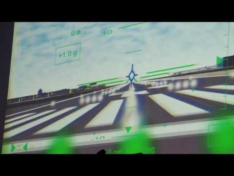 Harrier Jump Jet Test Pilot John Farley tries out a team's design