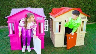 Ali and Adriana playing and build colored Playhouses
