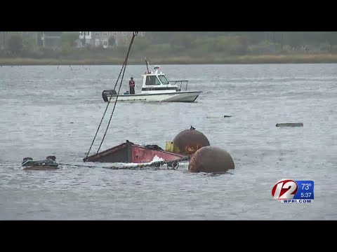 Large barge sinks into Providence River
