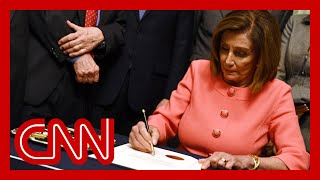 Pelosi signs impeachment articles against President Trump