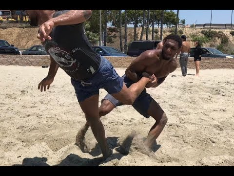 Mixed martial arts is no joke ! Pro bellator fighters Take downs in sand