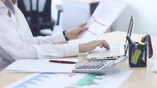 Female Employee Working In Office Stock Video