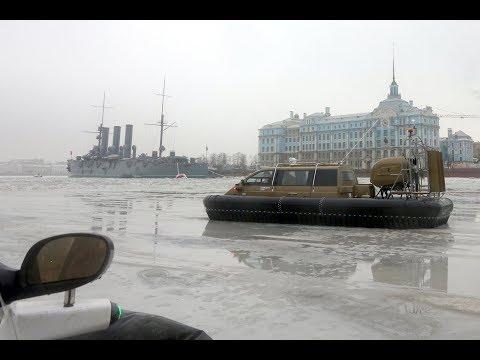 A walk along the Neva River, St.Petersburg,Russia. Hovercraft Christy 7186 FC , Cruiser Aurora
