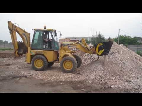 The MB-L Working With A Backhoe Loader - Mbcrusher.com