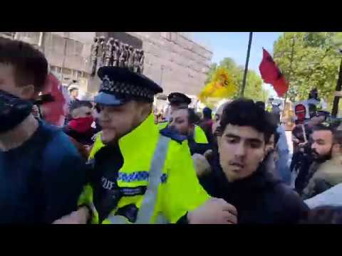 Violence between protesters and police over Erdogan's UK state visit.