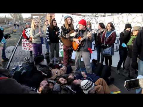 Dana Lyons singing with the Bellingham 12 prior to their arrest  Dec 12th