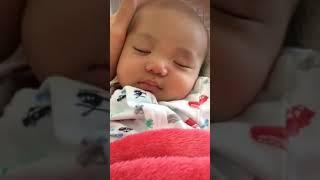 Baby Vu smiling in his sleep