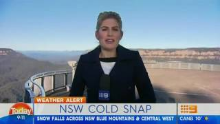 Sydney frozen by cold front as snow falls across New South Wales