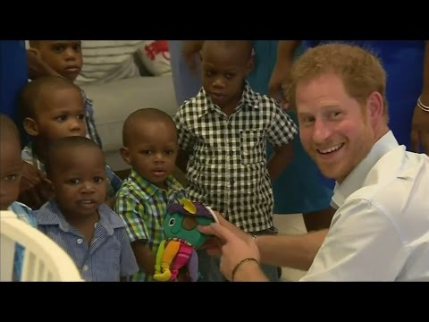 Prince Harry plays with children in Barbados